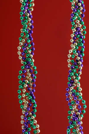 Mardi Gras beads over red Stock Photo - 915486