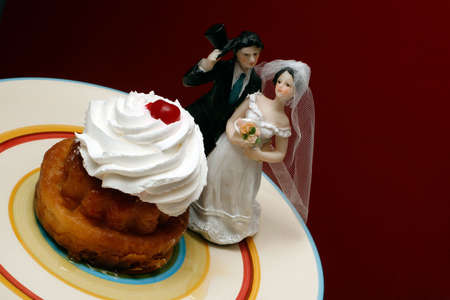 SAVARINA (Romanian dessert - cake and whipped cream) - with a bride and a groom dolls. Stock Photo - 915498