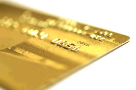 Golden credit card, macro, very shallow DOF.