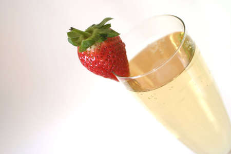 Champagne and strawberry, macro. shallow DOF with focus on the strawberry.