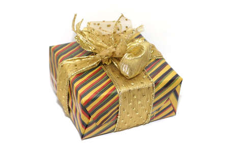 A gift, colourfully wrapped with a golden ribbon. shallow DOF Stock Photo - 915533