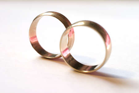 two gold wedding rings, pink reflections macro. shallow DOF Stock Photo