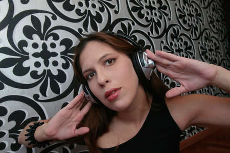 A woman listening to music in headphones