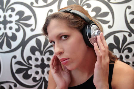 A woman listening to music in headphones photo
