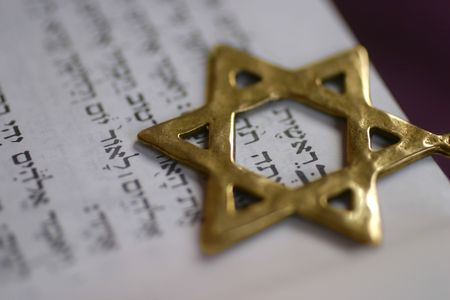 A Golden Star de David, symbole juif, sur le premier mot du livre de la Genèse.
