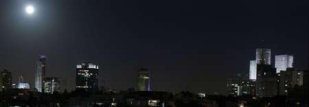 Tel Aviv at night, Full moon over Tel Avivs skyline, Israel.