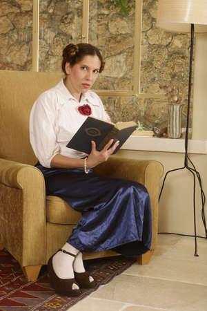 Young Jewish woman holding a holy book. (Jewish Mahzor - holiday prayer book) photo