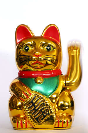Golden Maneki Neko, hand in motion Stock Photo