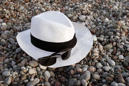 Summer vacation accessories - hat and sunglasses Stock Photo