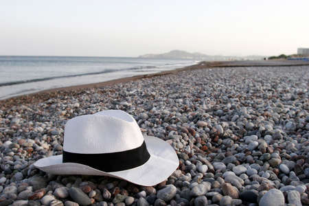 Summer vacation accessories - hat and sunglasses at dusk Stock Photo