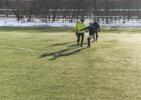 Moscow, Russia - March 16, 2018: amateur football game on the street in Moscow. Adults play soccer outdoors on a small pitch. Horizontal. Concept of healthy lifestyle Redactioneel