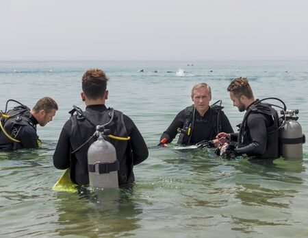 Eilat, Israel - May 2018: School of underwater diving. Men are training in diving. A popular water sport and leisure activity Editorial