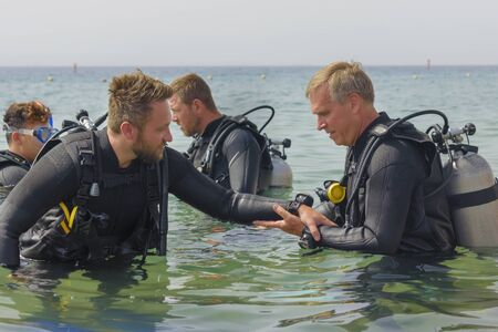 Eilat, Israel - May 2018: School of divers. Men are training in diving. Close up