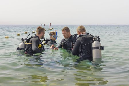 Eilat, Israel - May 2018: School of underwater diving. Divers group befor diving. A popular water sport and leisure activity