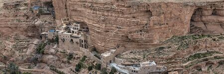 Monastery of Saints George and John Jacob of Choziba is Wadi Qelt. The cliff-hanging complex with its ancient chapel and gardens, nhabited by Greek Orthodox monks. Travel in Israel. Panorama