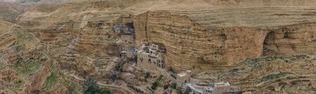Monastery of Saints George and John Jacob of Choziba is Wadi Qelt, Israel. The cliff-hanging complex with its ancient chapel and gardens, nhabited by Greek Orthodox monks. Landscape. Panorama Stock fotó
