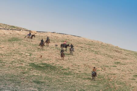 Israel - 15 Februar 2019: Horse riding in the desert. Landscape