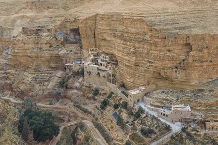 Monastery of Saints George and John Jacob of Choziba is Wadi Qelt. The cliff-hanging complex with its ancient chapel and gardens, nhabited by Greek Orthodox monks. Travel in Israel. Landscape