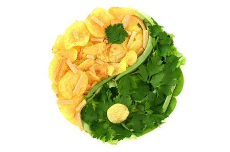 yin yang symbol: Yin and yang symbol made of healthy and unhealthy ingredients against white background