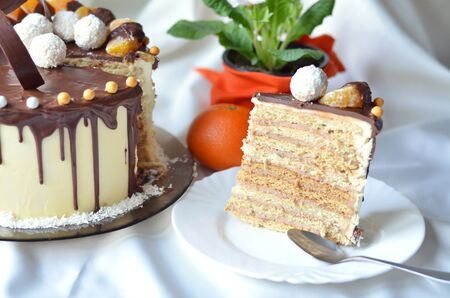 recipe decorated: Birthday cake decorated with chocolate and mandarin