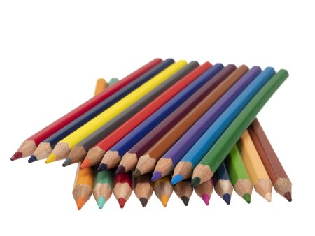 Lying colored pencils on a diagonal in two tiers. On a white background. Still life. Close-up.