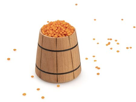 Red lentils in a wooden tub. Scattered grains around. Legumes Grain in a wooden bucket. On white background, isolated. Still life. Close-up. 写真素材