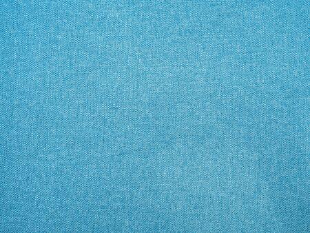 Denim in blue. Close-up. Texture. Background screen saver.