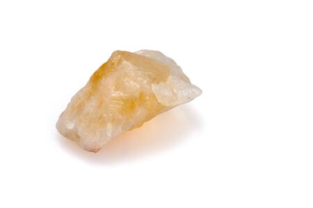 Mineral citrine on a white background. Decorative and ornamental stone. Nugget close up view. Jewelcrafting. Фото со стока
