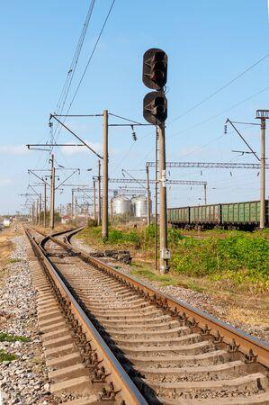 Ways of railway. Wagons on rails. Semaphore near the rails. Freight train. Stock fotó