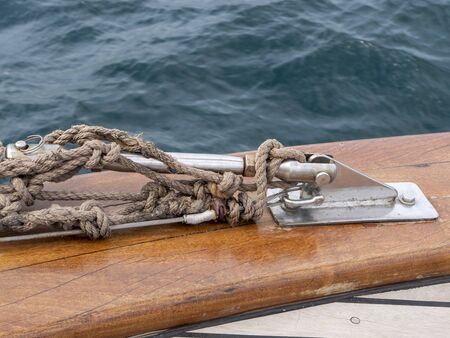 Ropes, anchorage on a yacht. Sea water. Summer day. Close-up.