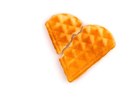 Broken heart. Crack. Heart shaped cookies on a white background. Isolated. Sweet waffles. Reklamní fotografie