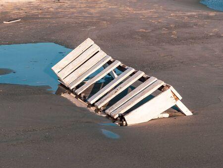 Broken sun bed on sea coast. Reklamní fotografie