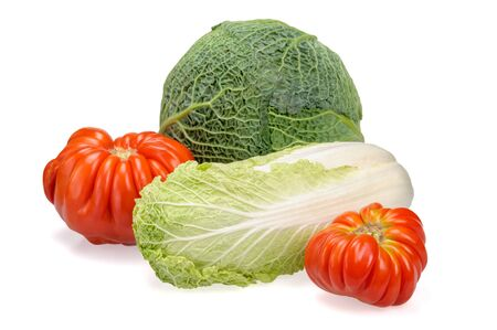 Organic cabbages, and tomatoes on white background