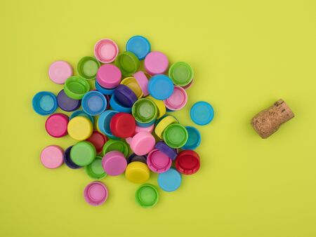 Natural materials and capping plastic bottles. Bright yellow background.