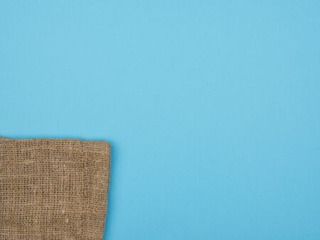 The texture of the burlap. The view from the top. Blue background.