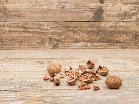 Chopped walnuts on wooden background. Close-up. Shelled nuts.