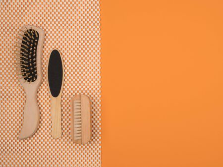 Various accessories for the care and health of the body on an orange background. The view from the top.