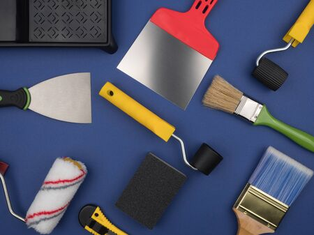 Construction tools for finishing works. Accessories a painter. Blue background.