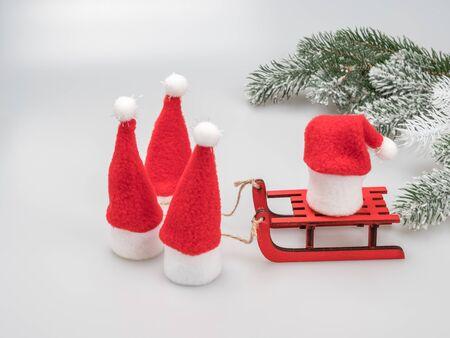 Christmas card. Little Santas hats-drawn sleigh. Snowy Christmas tree branch. Christmas card.