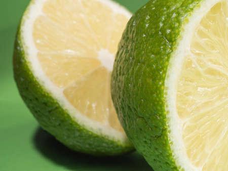 Lime halves on a green background. Citrus fruit. Macro.