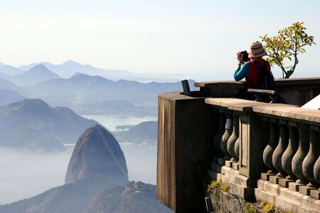 Tourist taking picture of the Sugar Loaf in Rio de Janeiro