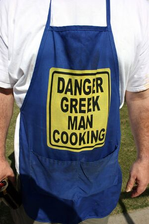 greek chef: Greek man cooking at the festival