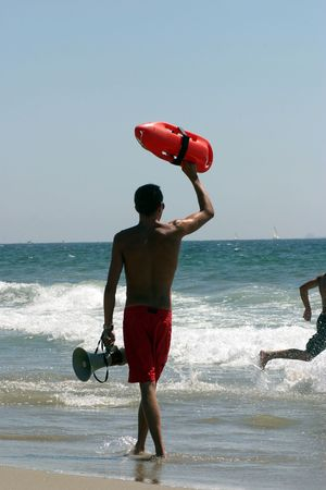 Lifeguard on California beach ready for rescue