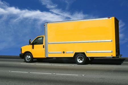 Yellow truck on the road