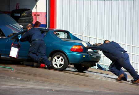 Broken car in autoshop Stock Photo