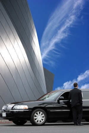 Limousine driver waiting for passenger Stock Photo