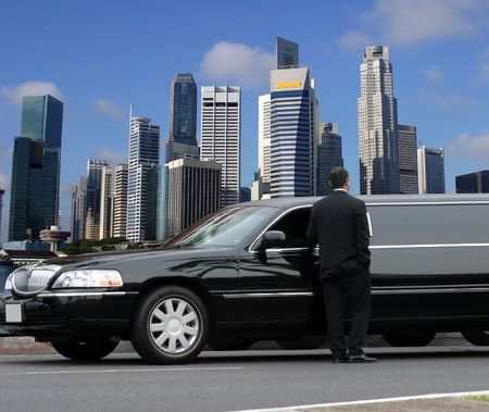Limousine driver waiting for passenger in Singapore Stock Photo - 2341234