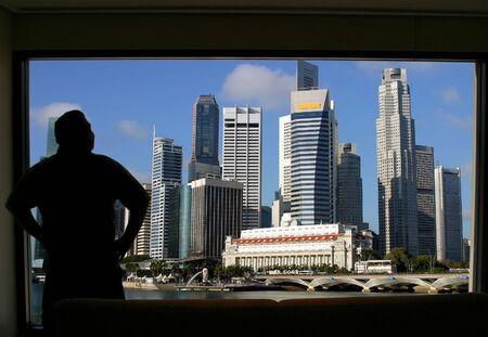 Tourist enjoying the view of Singapore skyline Stock Photo