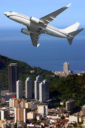 Airplane over Ipanema beach in Brazil photo