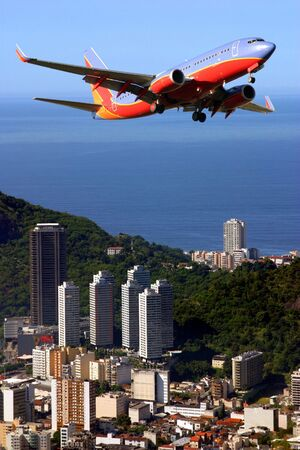 Airplane over Ipanema beach in Brazil Stock Photo